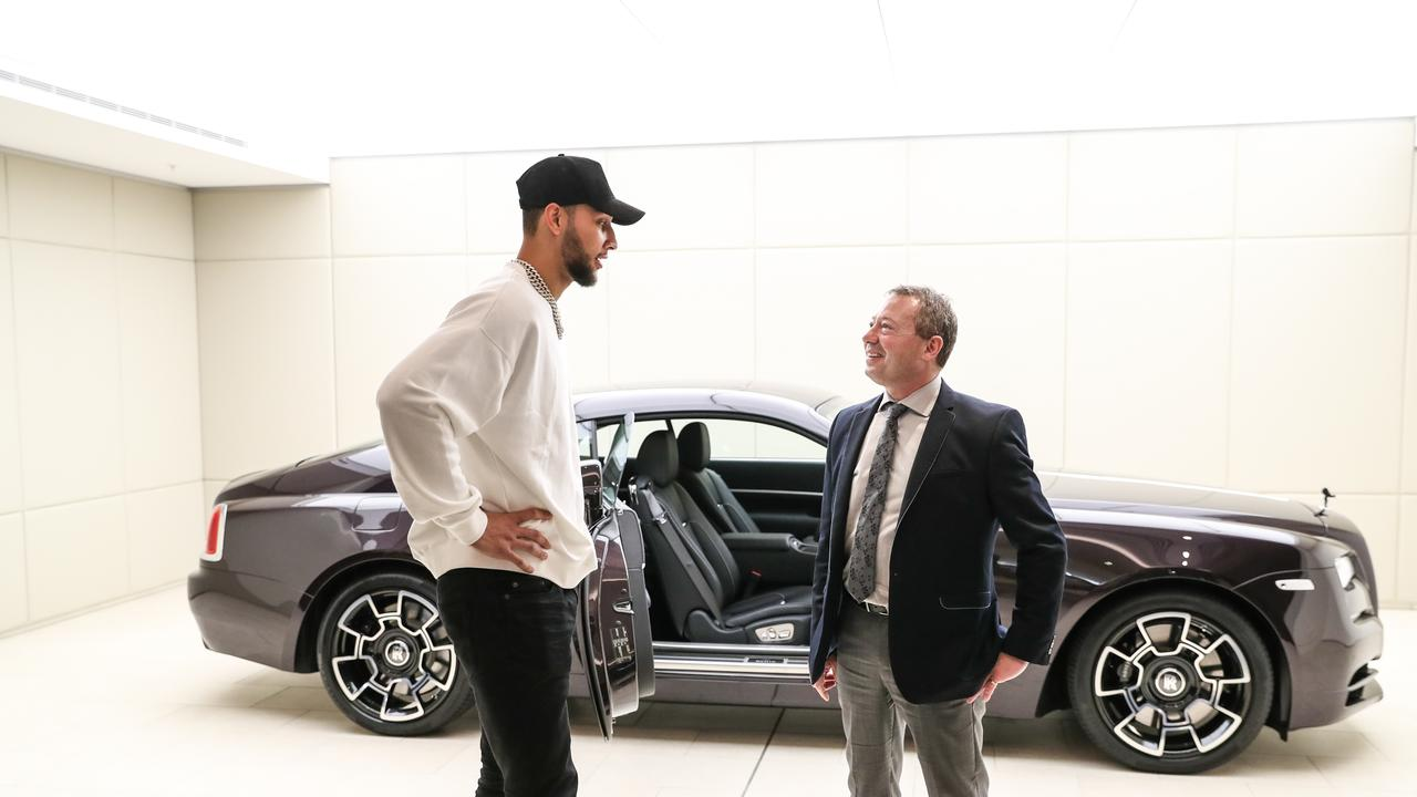 Simmons with Paul Ellis, general manager of marketing for Zagame Automotive. Picture: Supplied