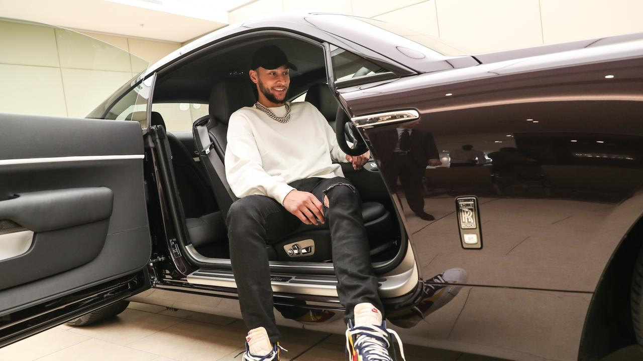 Ben Simmons with an $800,000 Rolls-Royce Wraith Black Badge from Zagame Rolls-Royce in Richmond. Picture: supplied.