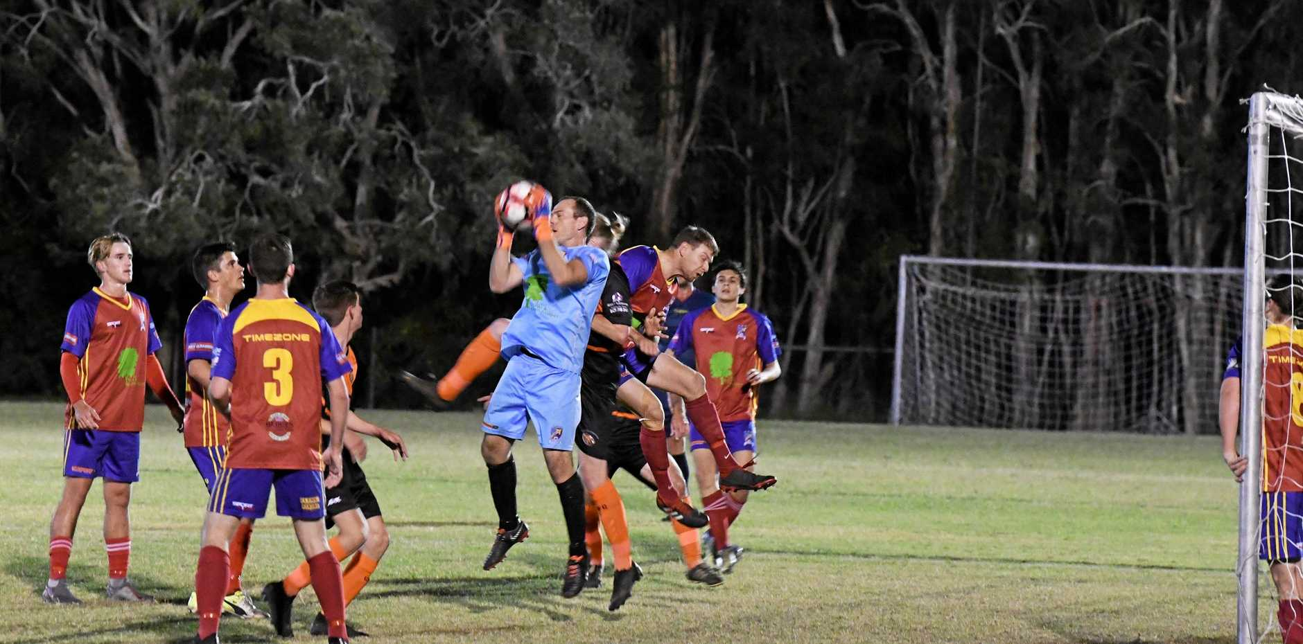KSS Jets goalkeeper Tim Murray leaps high to stop the cross from the corner.