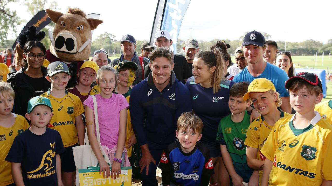 Wallabies captain Michael Hooper and Grace Hamilton of the Wallaroos at the UWA Sports Ground in Perth. Picture: Getty Images