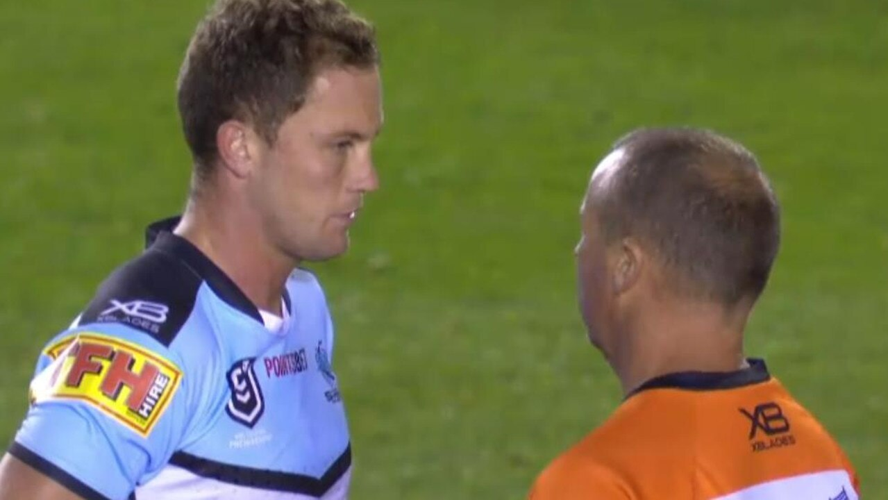 Cronulla's Matt Moylan is attended to by the Sharks trainer after copping a hit from Sam Burgess. Credit: Fox Sports