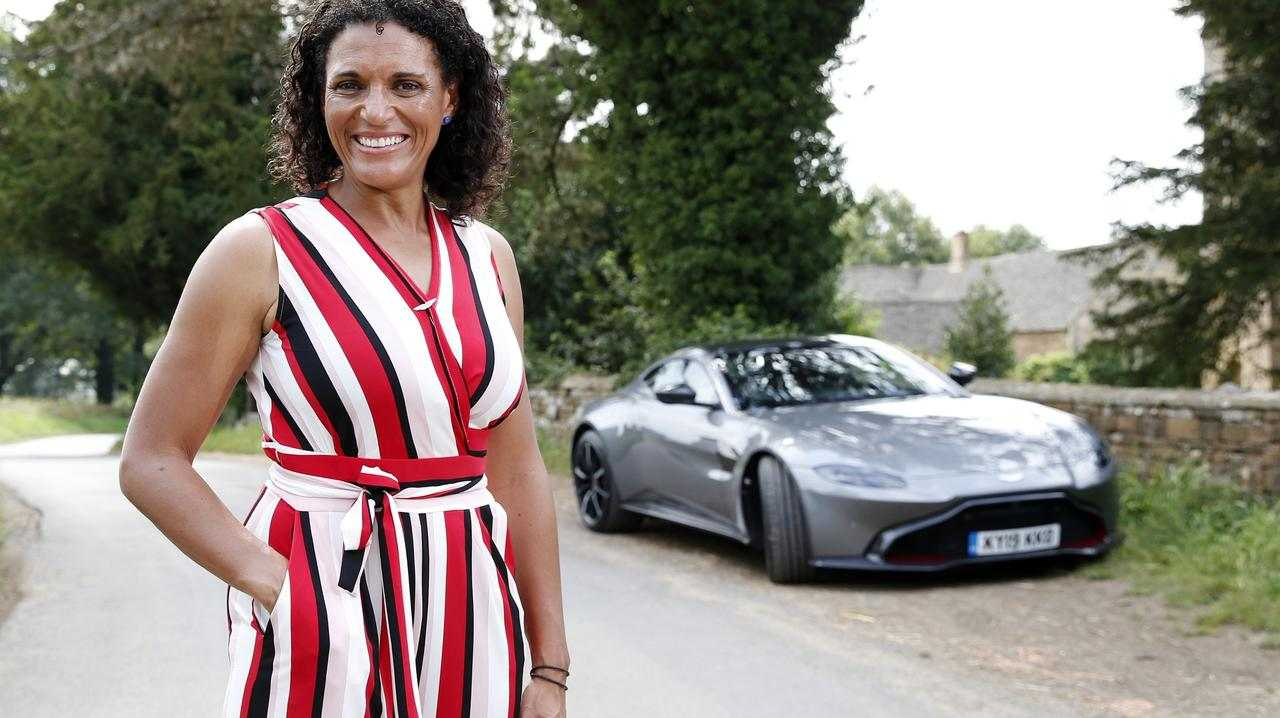 Cricket commentator Mel Jones with an Aston Martin Vantage.