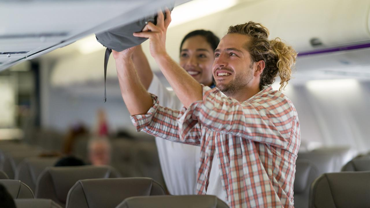 Most flight attendants are simply not required to lift your luggage