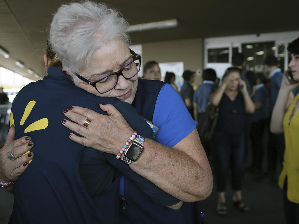 Walmart employees comfort one another after a gunman opened fire. Picture: Mark Lambie/The El Paso Times via AP