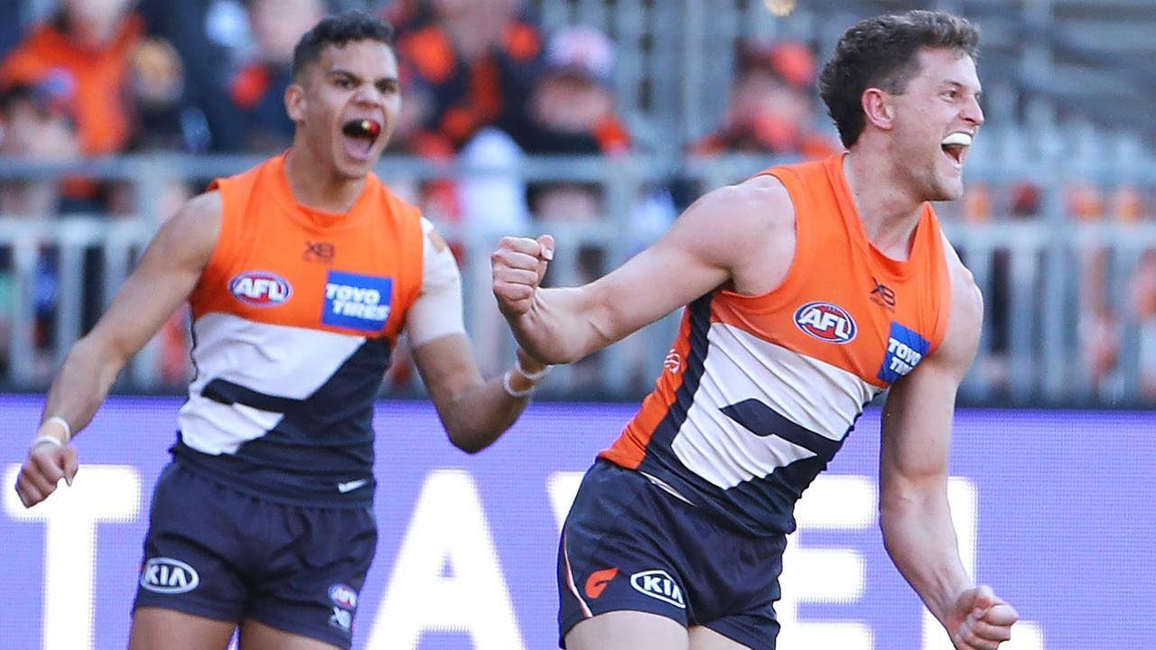 Jacob Hopper celebrates kicking a goal during the clash with the Swans. Picture: AFL Photos/Getty Images