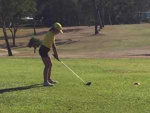 Linzi McBean swings down fairway
