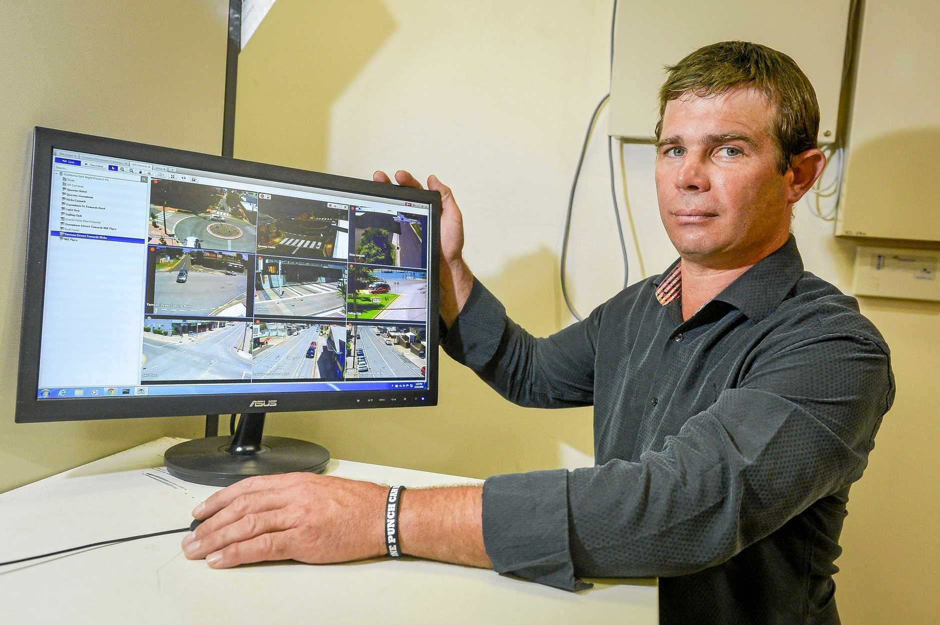 SENT HOME: Safe Night Precinct Gladstone chairman Aodhan McCann pictured with footage from CCTV cameras which were installed in the CBD late last year.