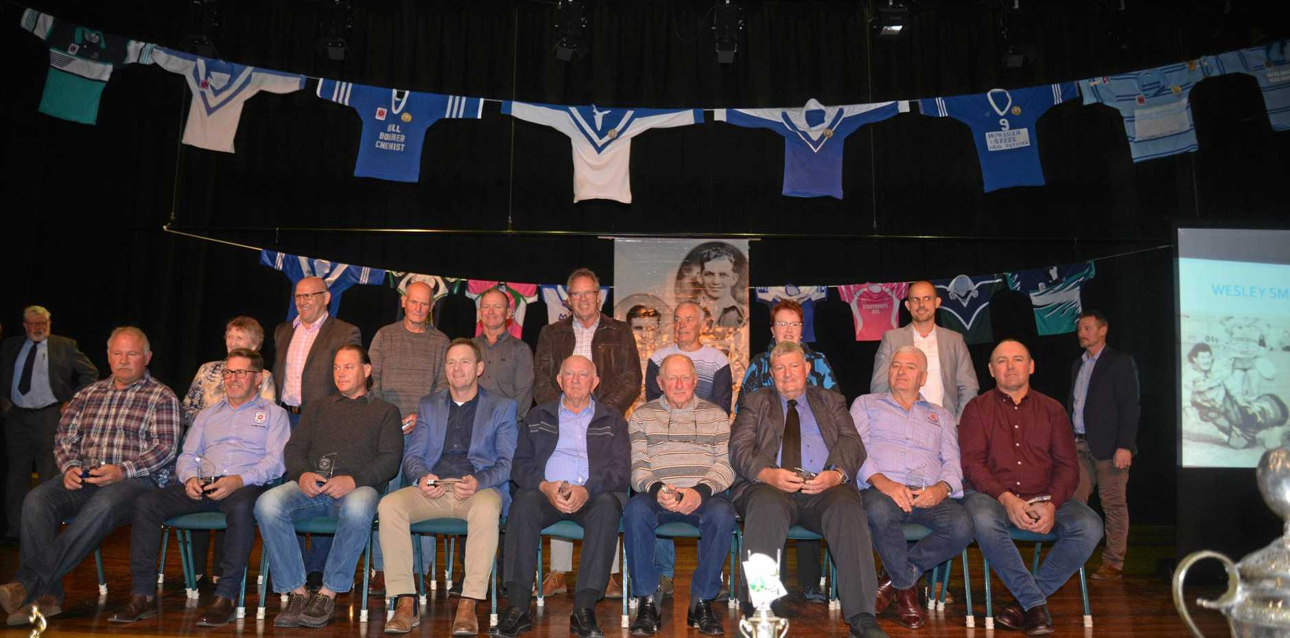 The Stanthorpe Rugby League Team of the Century (front, from left) Wesley Smith, Les Sellars (deceased, represented by past club president and 100-year committee member David Ball), John Scott (deceased, represented by son Grant Scott), Rob Reeves, Bob Newlands (represented by friend and 100-year committee member Ray Reeves), Peter Mavin, Peter