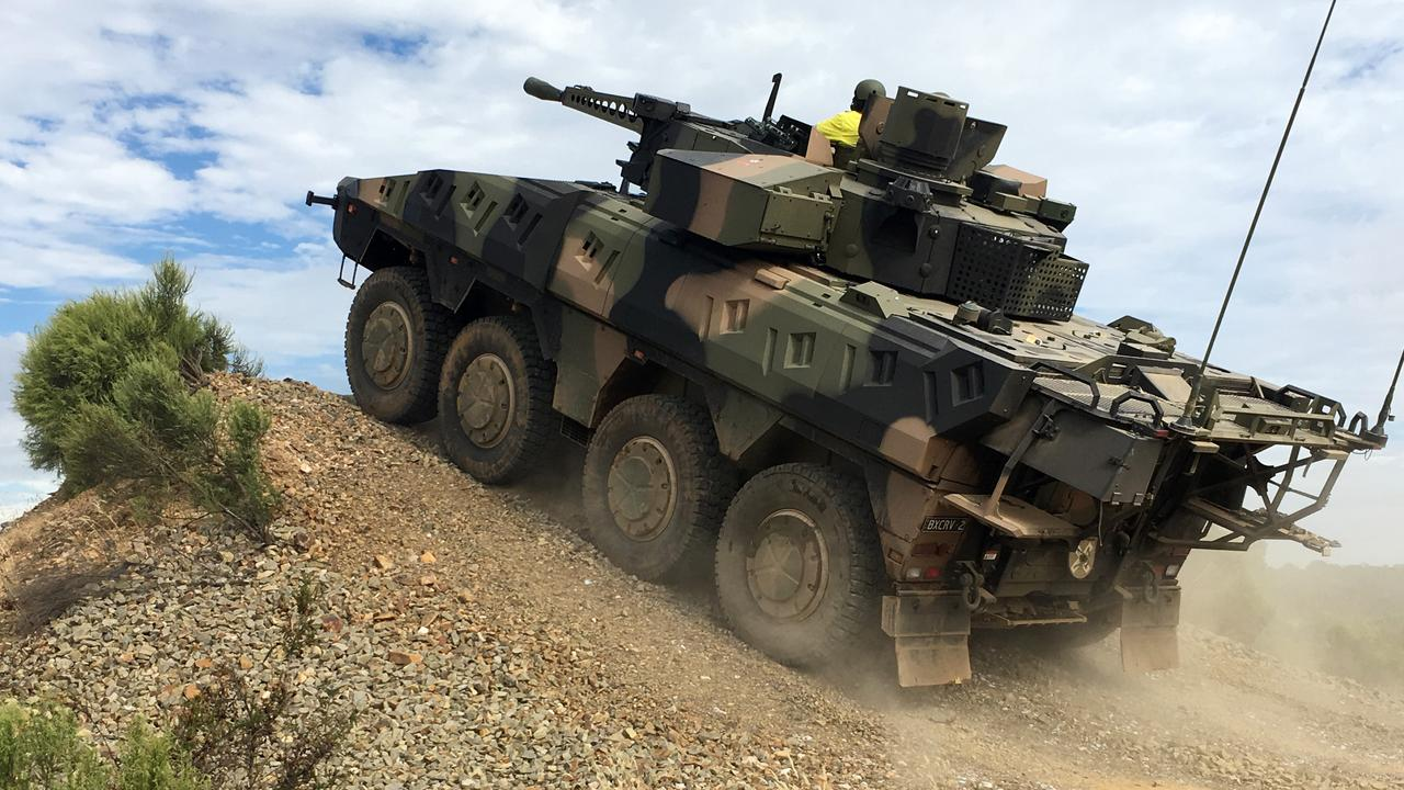 A Rheinmetall Boxer CRV negotiating obstacles on the Driver Training Circuit at Puckapunyal Military Area, near Seymour in Victoria