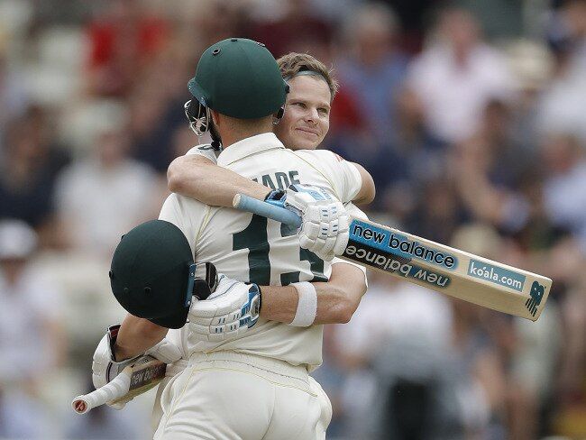 Smith is congratulated by teammate Matthew Wade.