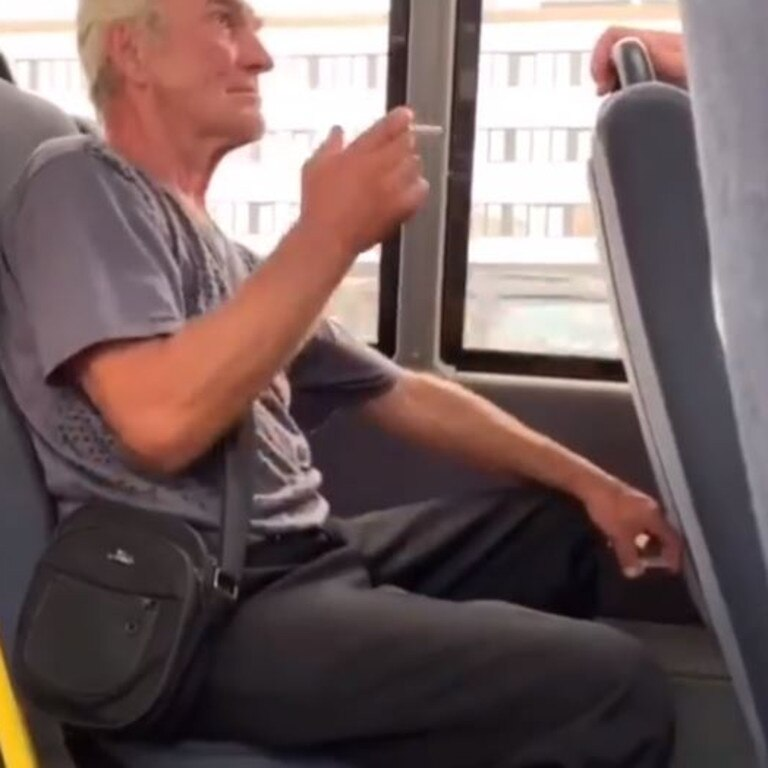 The man was filmed smoking on a bus before he was approached by another man. Source: Humans of Bankstown