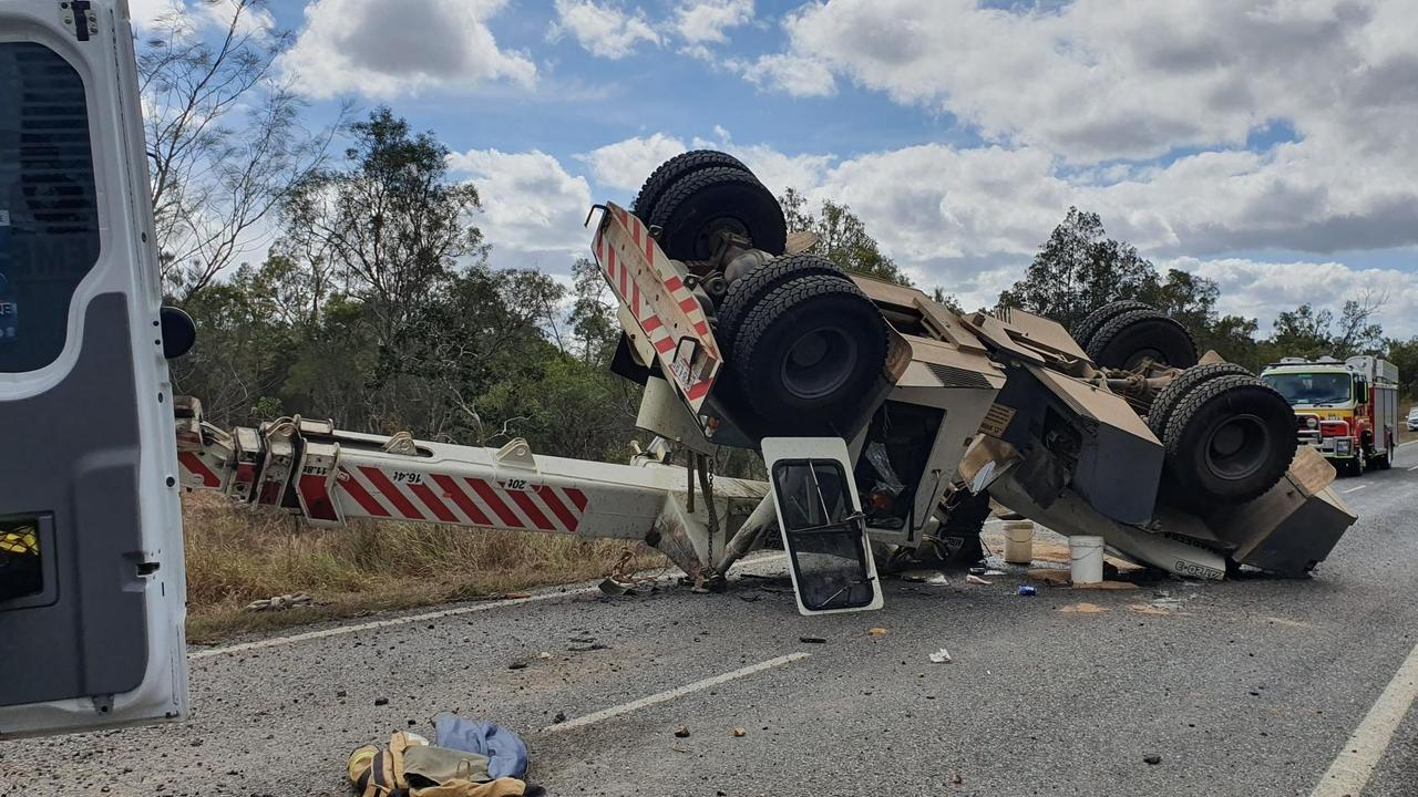 Two men were injured after a crane rolled on the Mareeba Dimbulah Rd near Mareeba, causing damage to the road. Picture: QPS