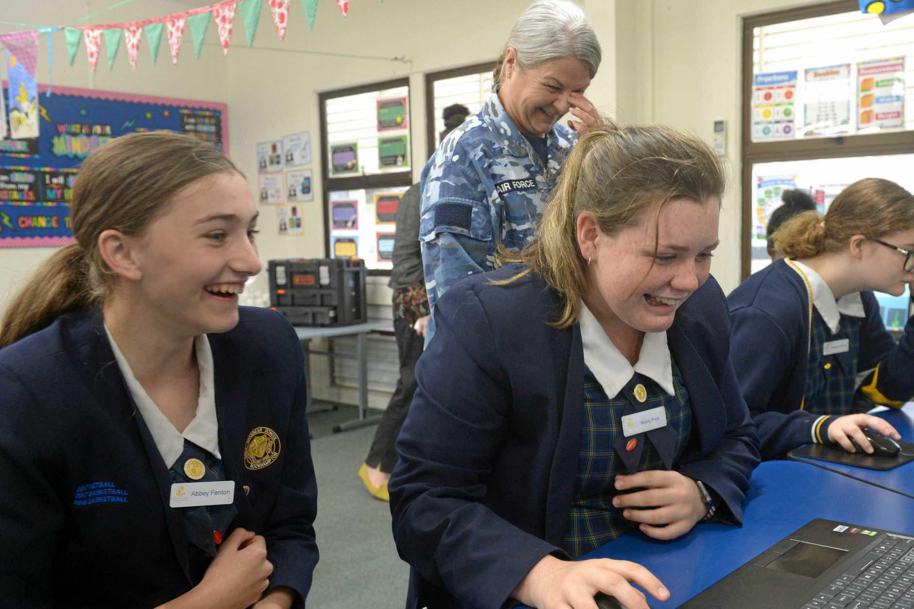 Abbey Fenton, Flight Lt Kylie Willmott and Maddy Price on the air traffic control simulator at Rockhampton Girls Grammar School