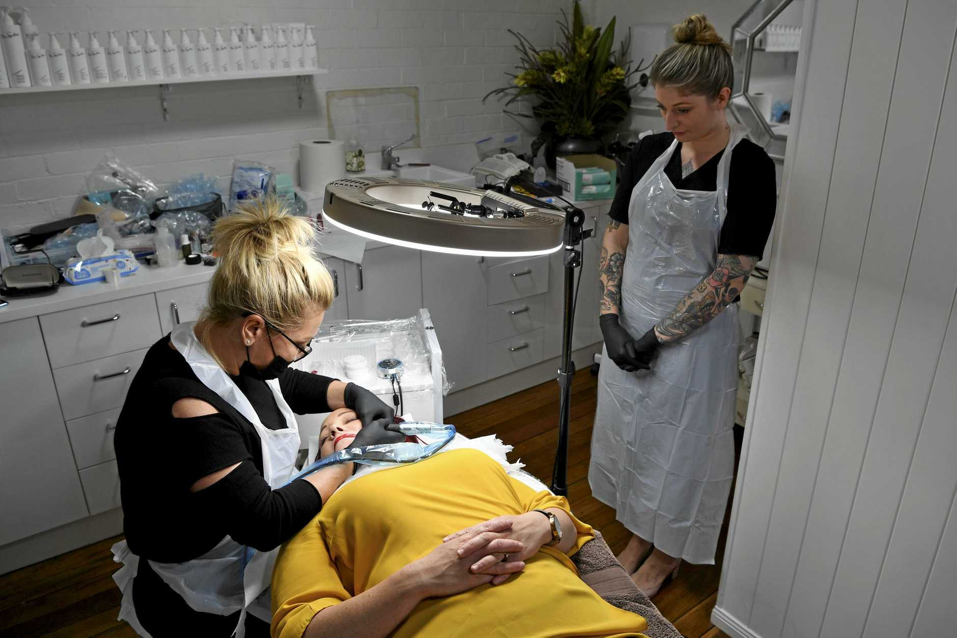 2019 UK cosmetic tattooist of the year Stefanie Toms at work on Amy Klein watched by Nicole Prance during a master class at Toowoomba's Beauty Effects, Tuesday, August 6, 2019.