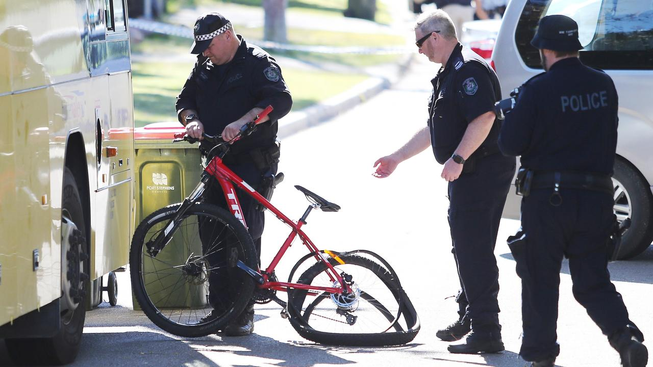 Police recover the bicycle the boy was riding. Picture: Peter Lorimer