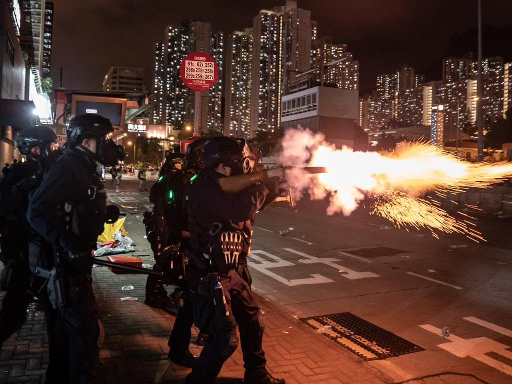 Riot police fire tear gas at protesters during a demonstration in Wong Tai Sin District on August 5 in Hong Kong. Picture: Anthony Kwan/Getty Images