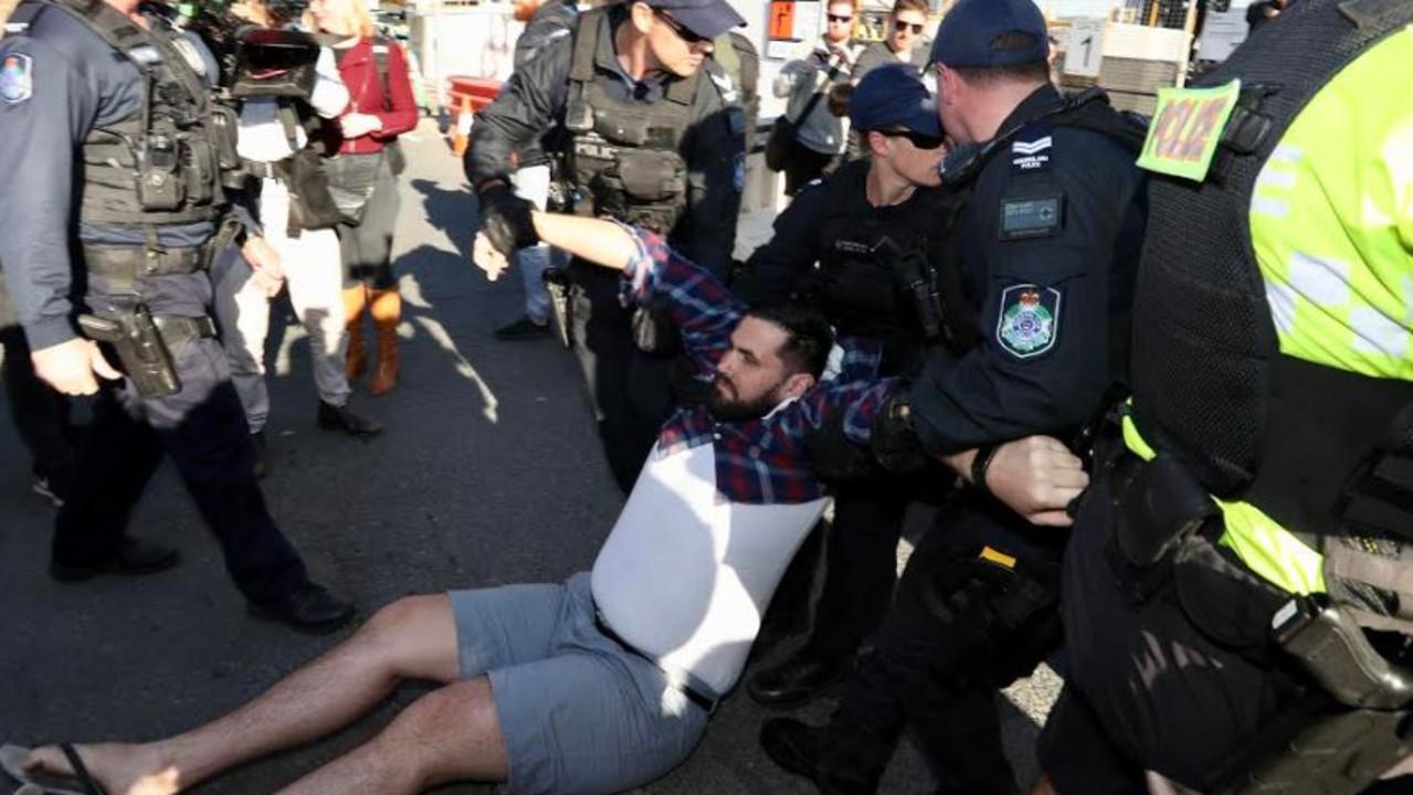 Police arrest protester in Brisbane's CBD. Picture: Liam Kidston