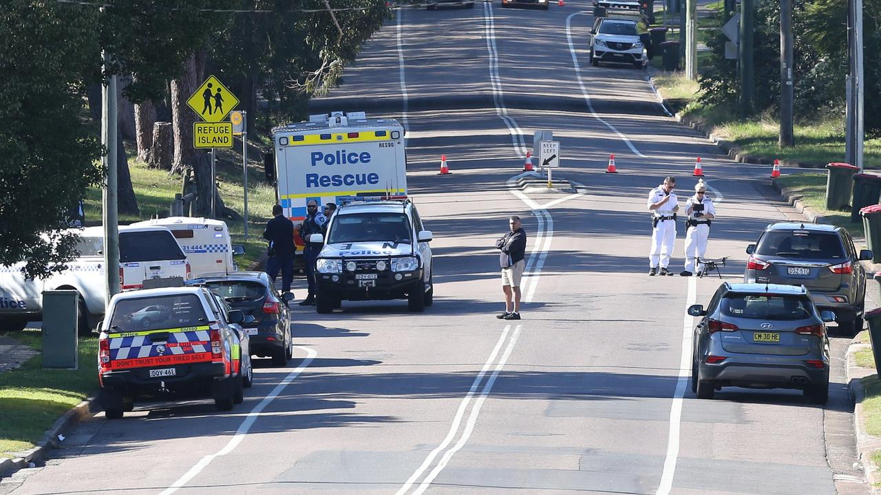 Emergency services at the scene where a Year 10 student was hit by a bus and killed on his way to school. Picture: Peter Lorimer