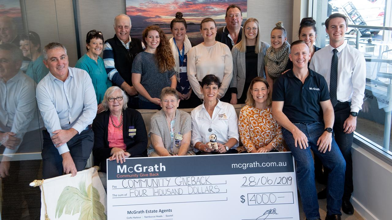 GIVING BACK: McGrath Estate Agents hand over their latest lot of donations to comunity groups.