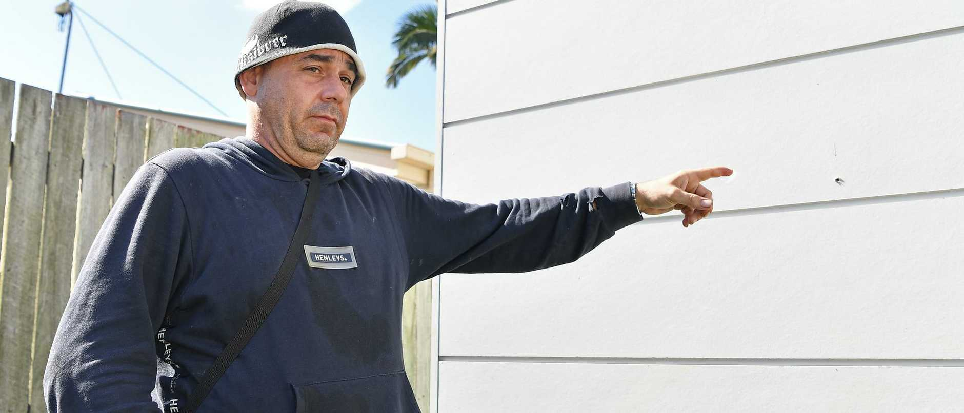 Nambour's Michael Eugene shows where his neighbour's unit was shot up.