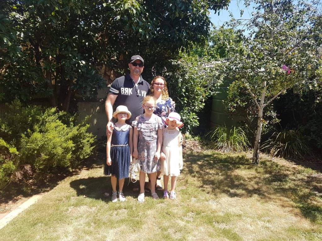 Mathew Werfel, 42, with his wife Jenny and three daughters, aged 10, 7 and 6. Picture: Supplied By Family