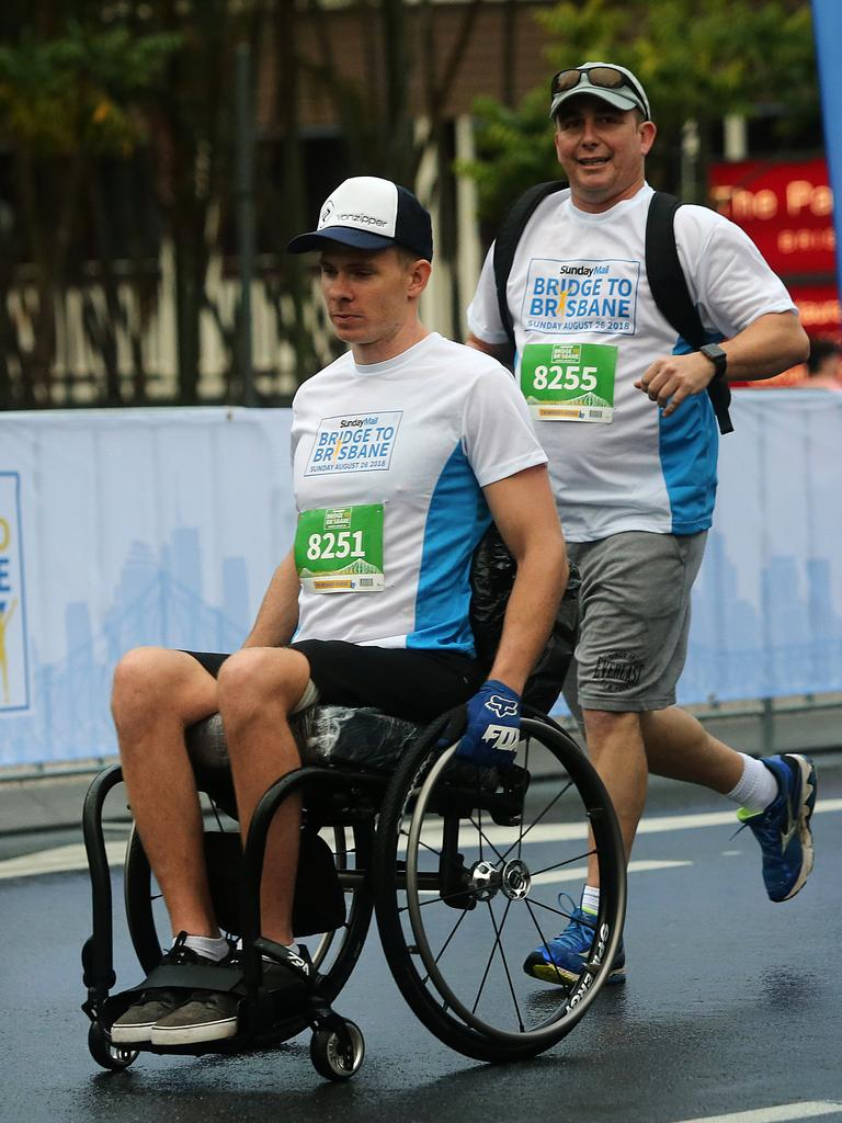 Rohan Sills tackles the Sunday Mail Bridge to Brisbane Fun Run last year. Picture: AAP Image/Jono Searle