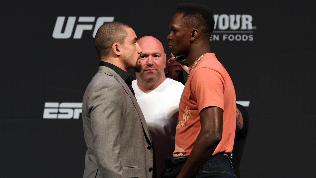 Robert Whittaker and Israel Adesanya face off. Picture: Getty