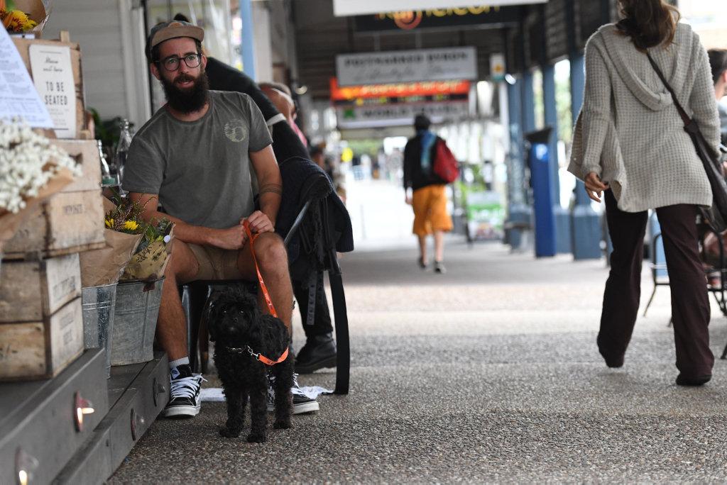 Cam Martin with Banjo in Byron Bay enjoying the dog