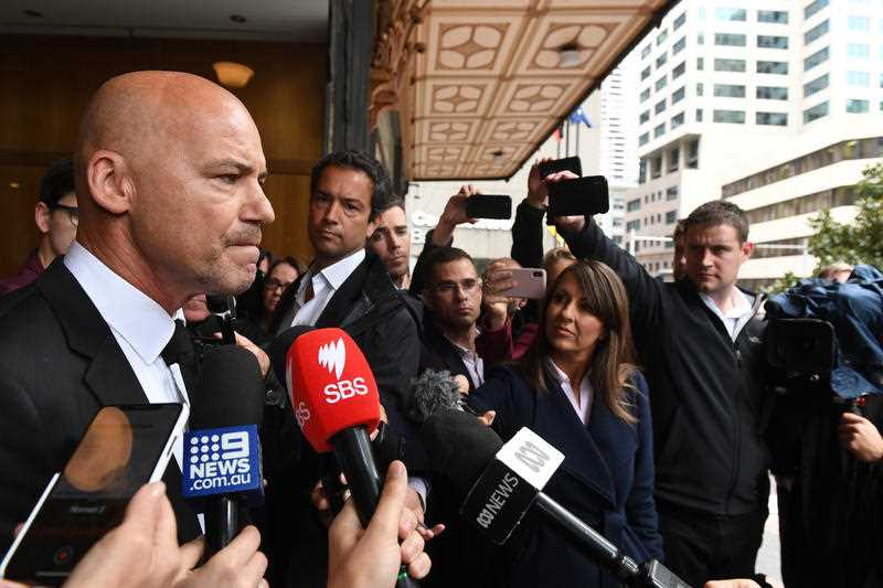 Former NSW Detective Gary Jubelin speaks to the media as he leaves the Downing Centre Courts in Sydney, Tuesday, July 30, 2019.