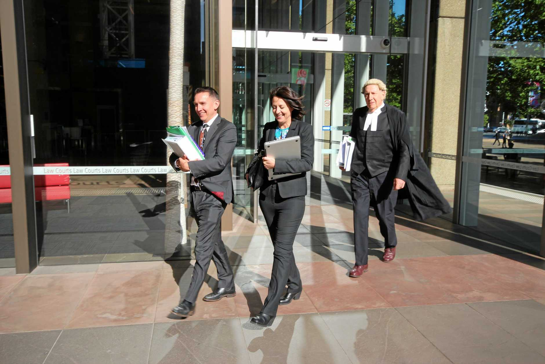 Esther Rockett (centre) leaves Sydney Supreme Court with solicitor Stewart O'Connell and barrister Tom Molomby after a December, 2018 hearing in the defamation case brought against her by Universal Medicine leader Serge Benhayon.