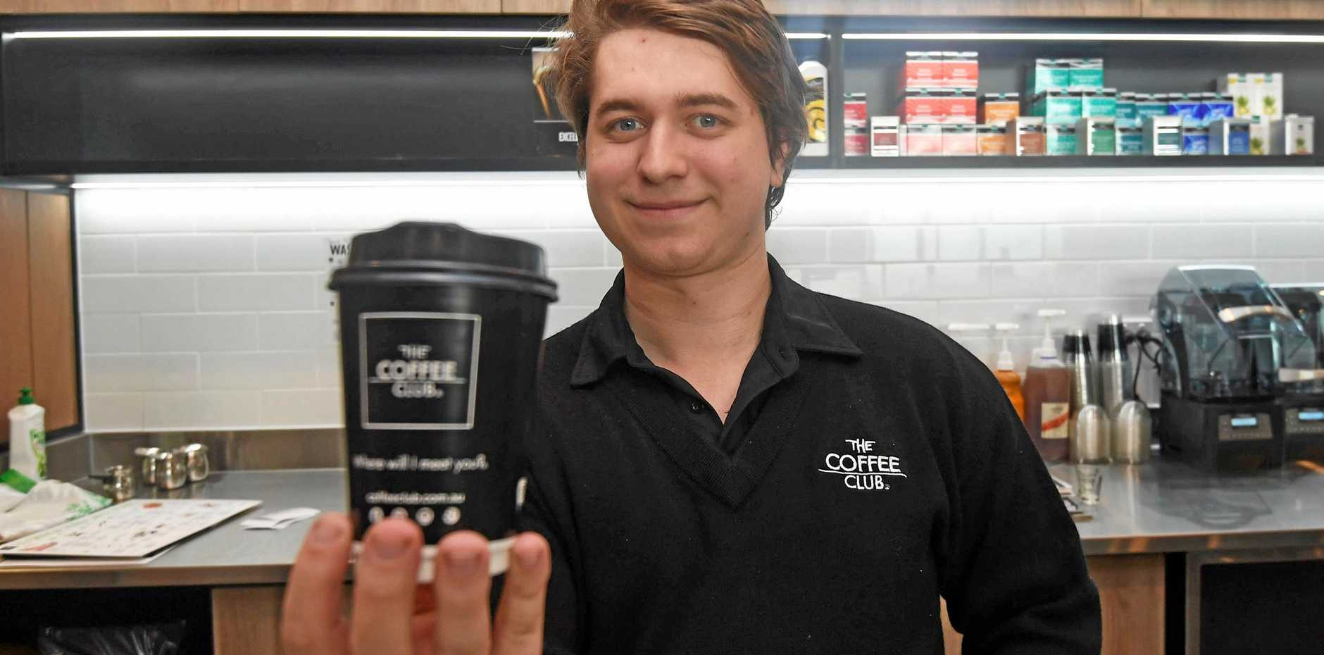 SNEAK PEEK: All will be revealed when the Gympie Coffee Club opens in Central Shopping Centre on Thursday. Ready to serve is Alex Korica.