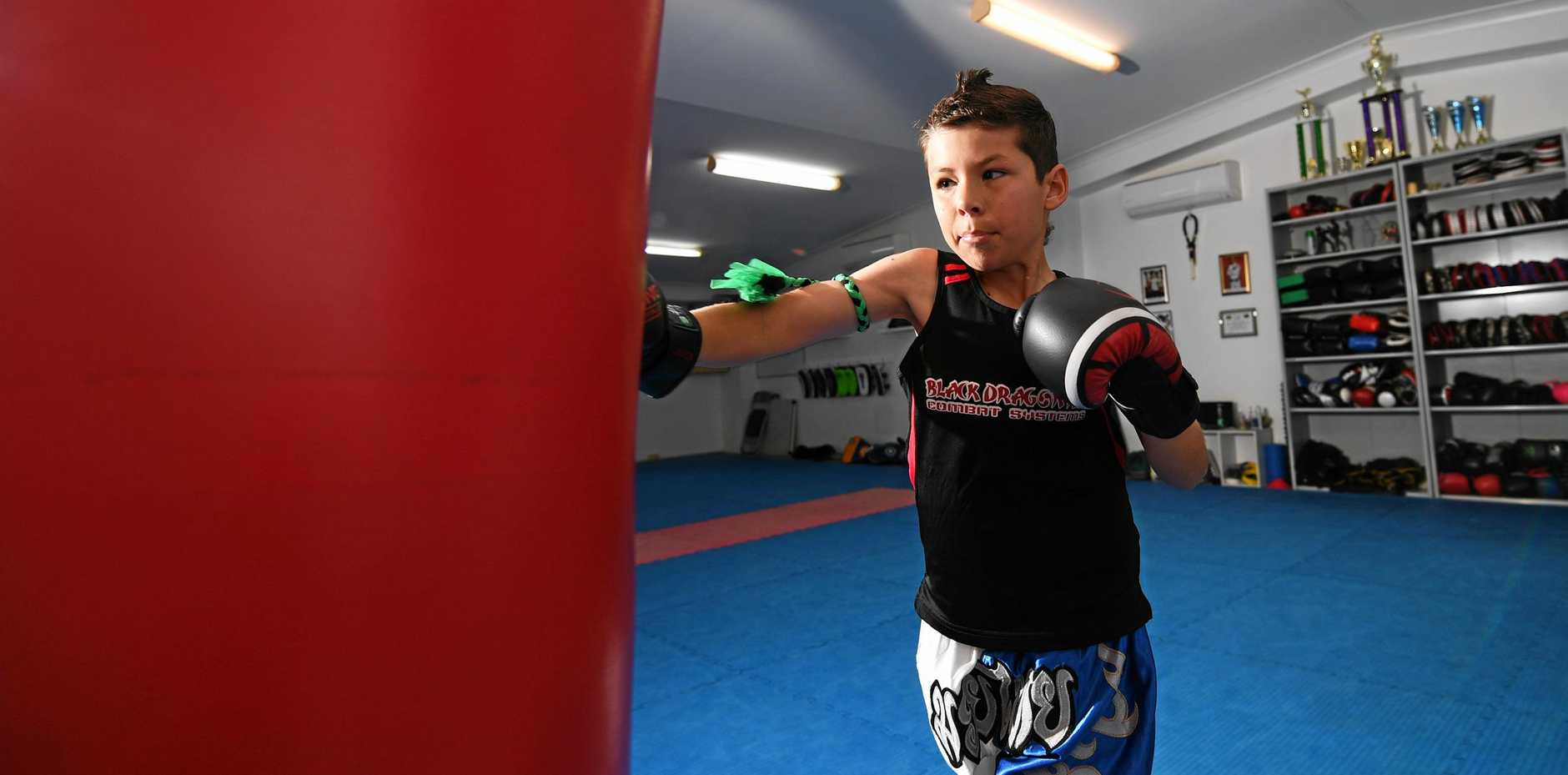 POCKET DYNAMO: Rockhampton muay thai fighter Cooper Ward packs a punch at a training session at Unison Martial Arts.