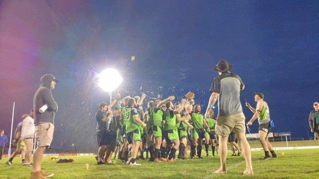 The Proserpine-Whitsunday Raiders take a moment to celebrate their victory.