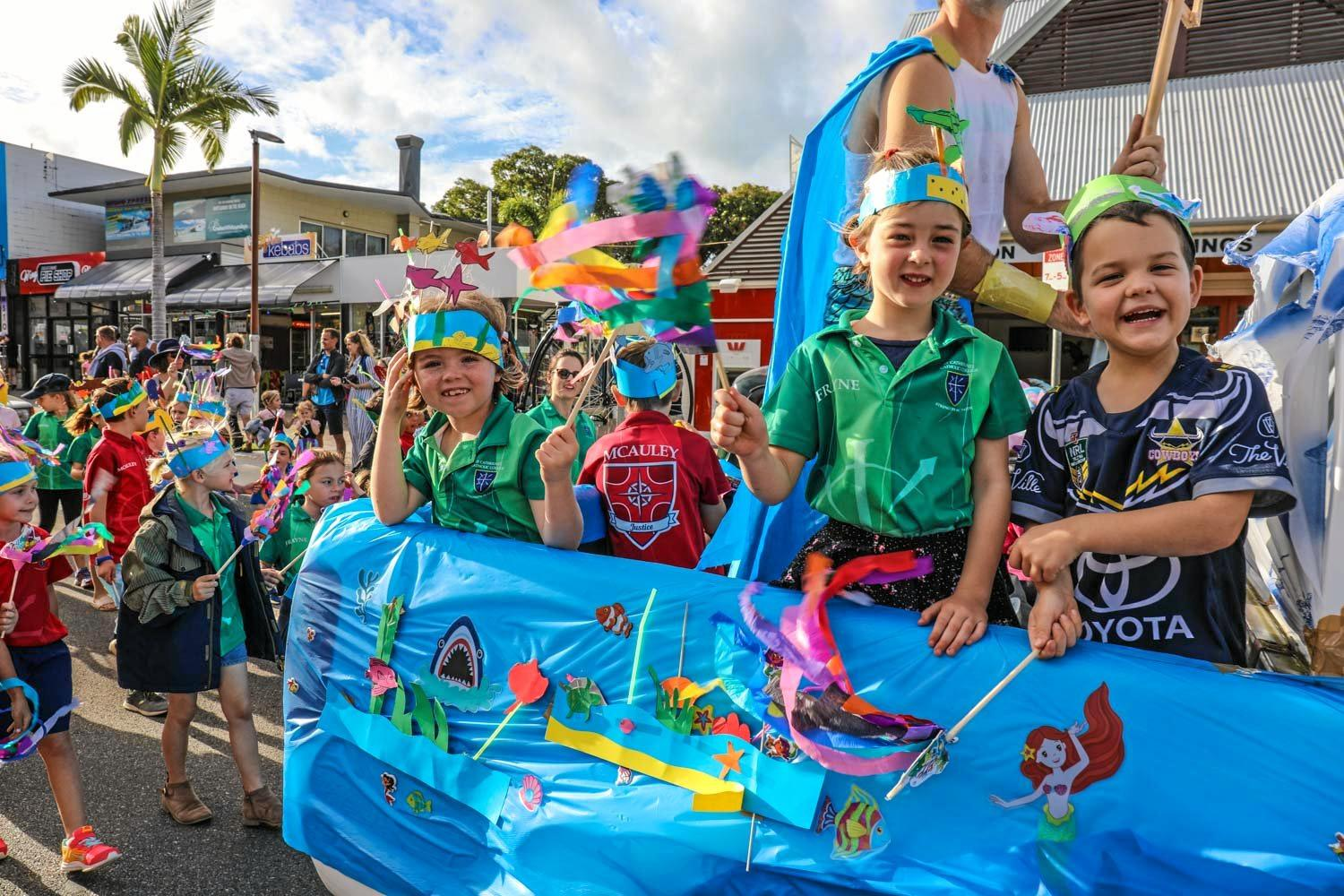 ALL SMILES: Children of all ages enjoyed the 2019 Rotary Street Parade in Airlie Beach.