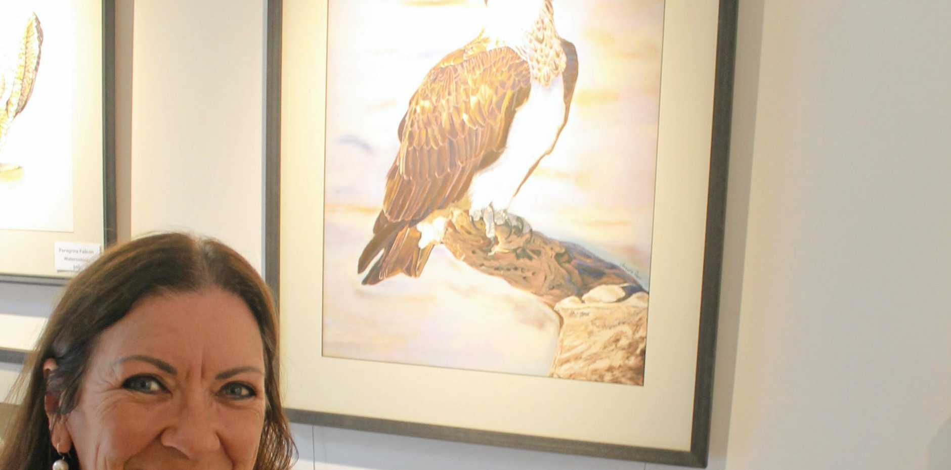 BIRD WATCH: Knockrow artist Angela Parr with her osprey painting, which is a finalist in a prestigious national award.