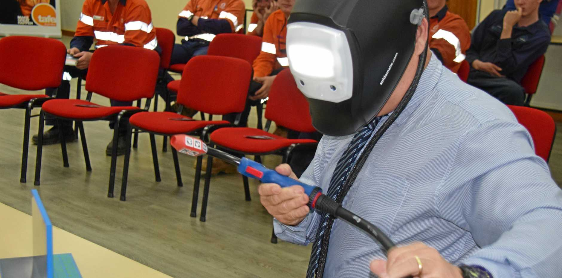 AUGMENTED REALITY: Garry Hargreaves from Tafe Queensland demonstrates fusion welding to attendees at the South West Tafe in Kingaroy.