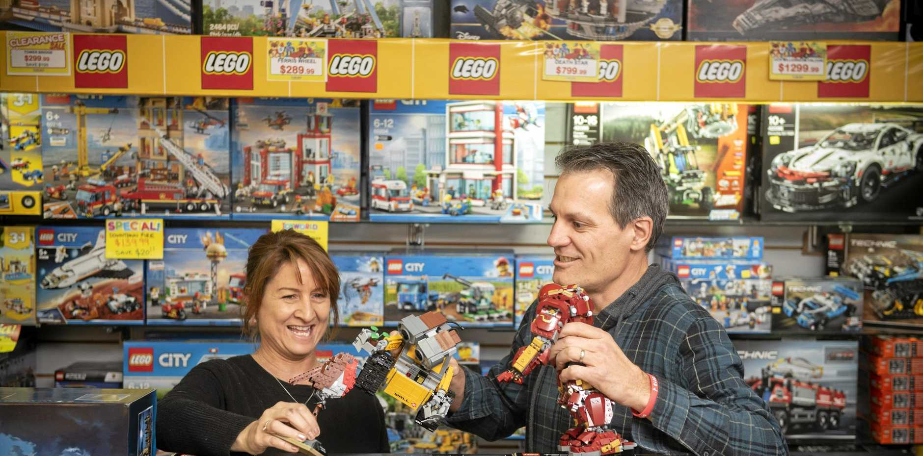 Toyworld Maclean owners Sharon and Boyd Moore play with one of their favourites, the vast Lego collection.
