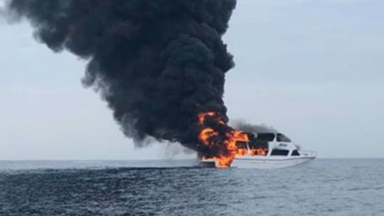 A photo taken from a nearby vessel shows the boat engulfed in flames.