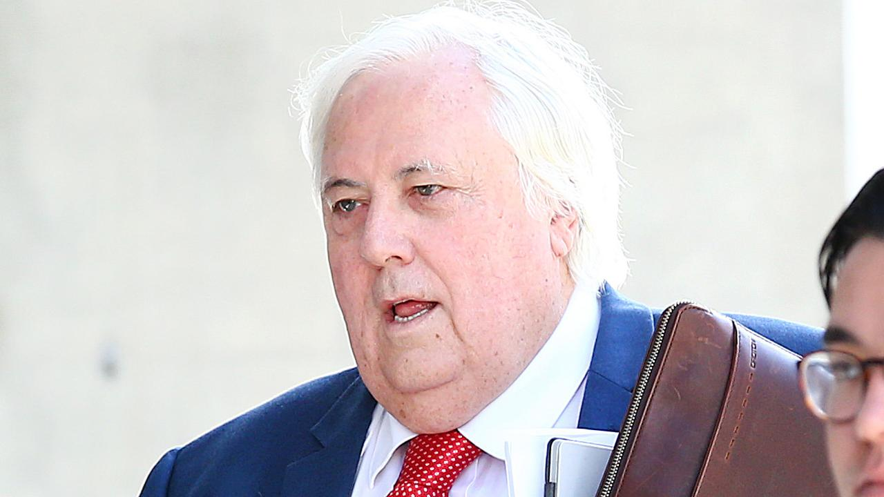 Businessman Clive Palmer arrives at the District Court in Brisbane where liquidators have been trying to claw back $200 million in claims over the collapse of Queensland Nickel. (AAP Image/Jono Searle)