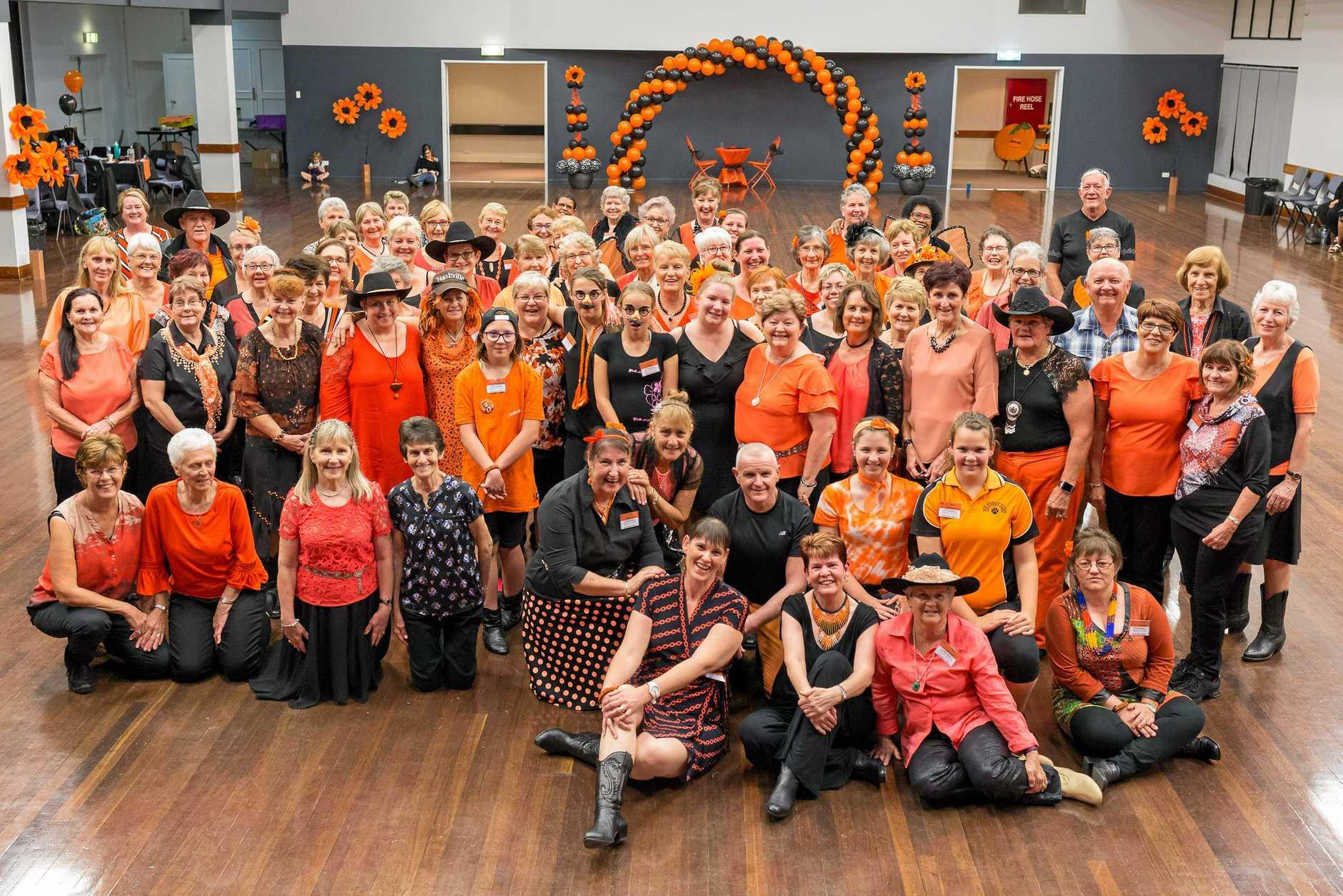 LINE DANCING: Dancers enjoy the 'Orange is the New Black' theme at Gordon Elliott's last workshop weekend at Boots 'n' All Line Dancing.