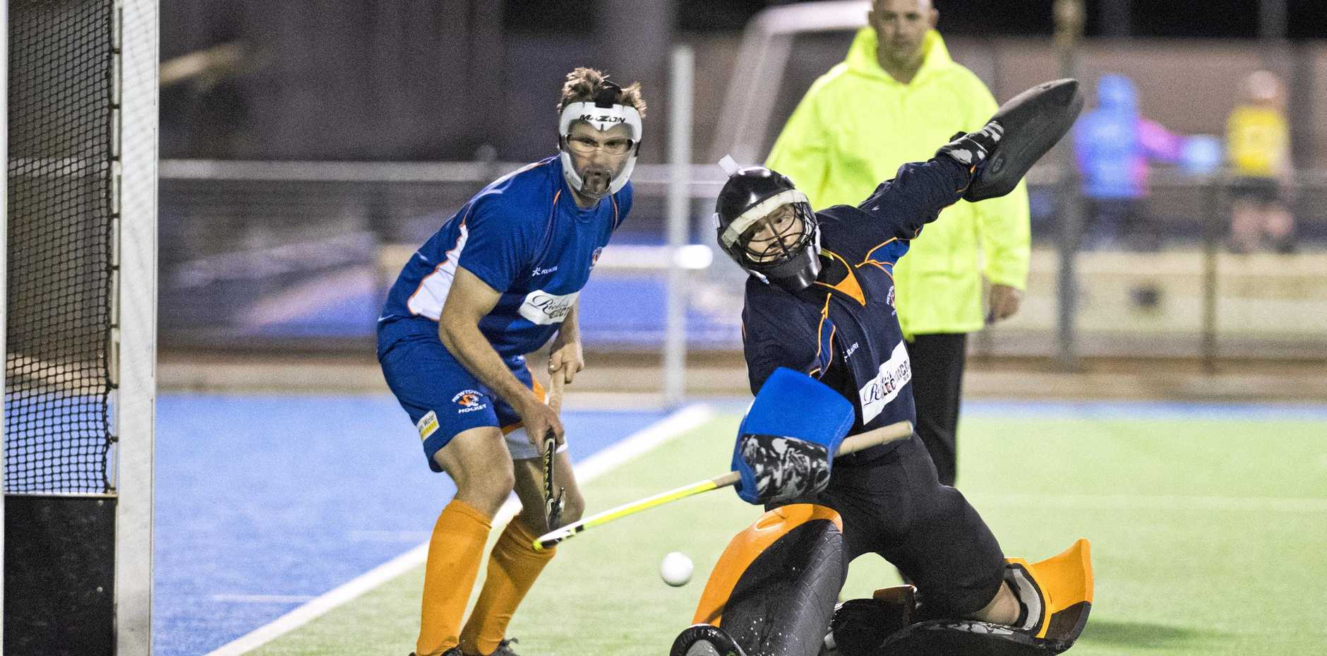 CRACKING SAVE: Newtown goalkeeper Michael Elsasser makes a save from a penalty corner against Past High.