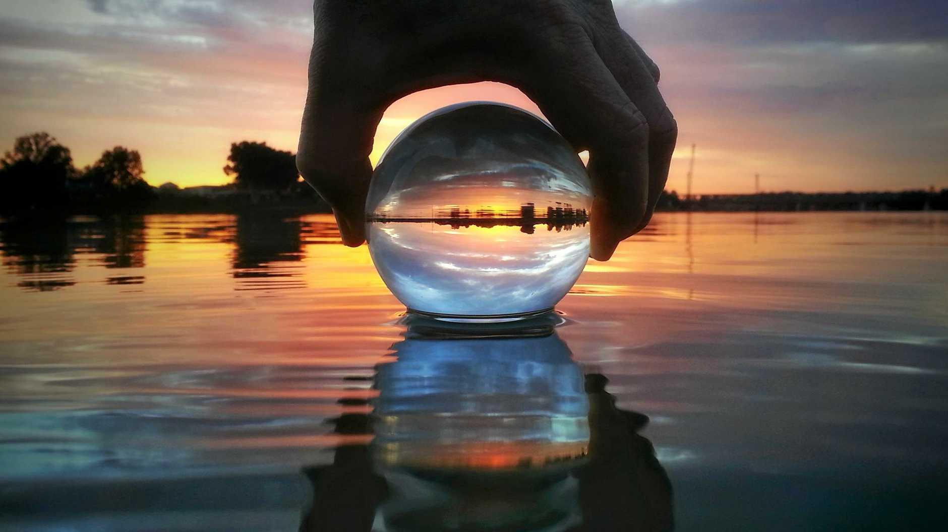 RIVER ORB: This creative shot on the Clarence river wonderfully captures a bright sunset.