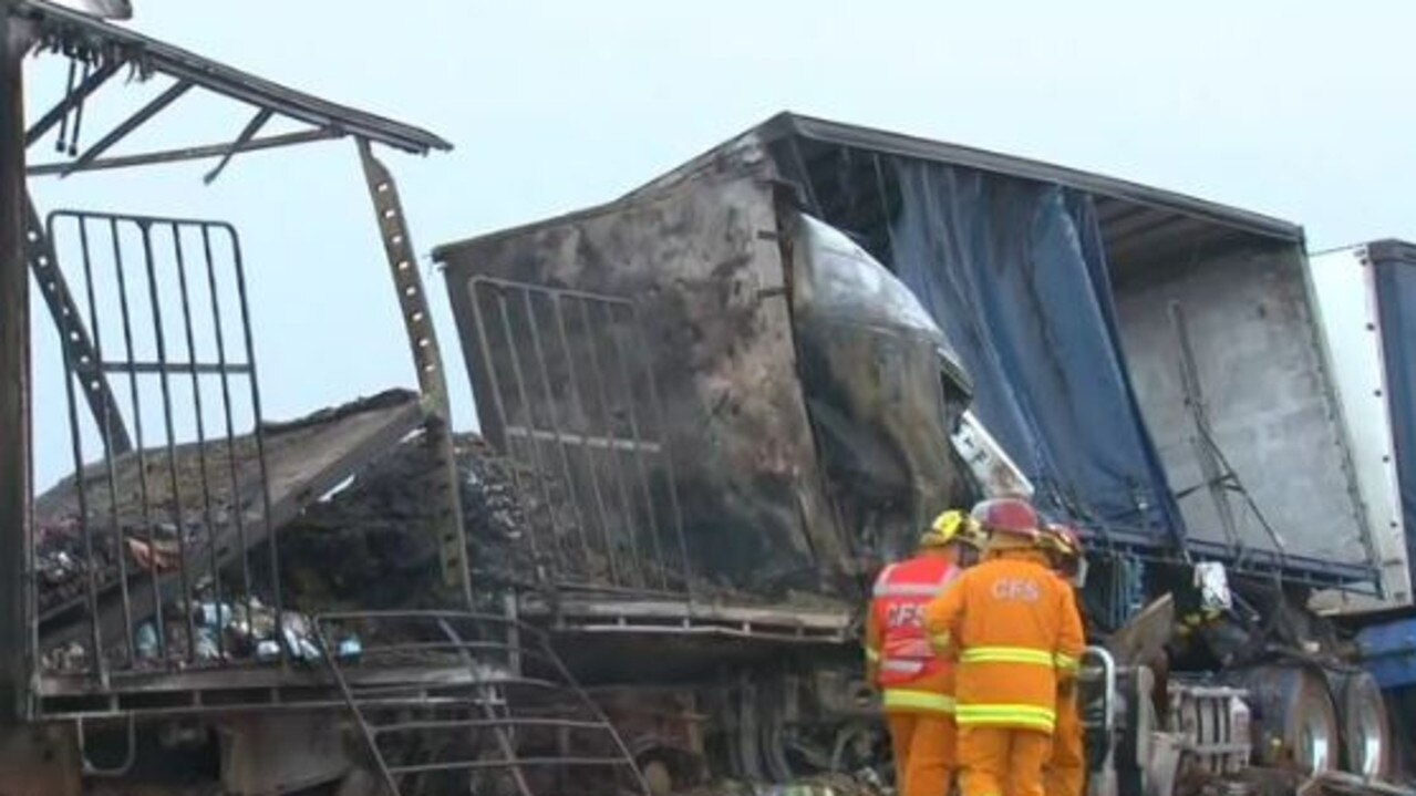 Two men have died in a head-on truck crash amid wild weather hitting South Australia.