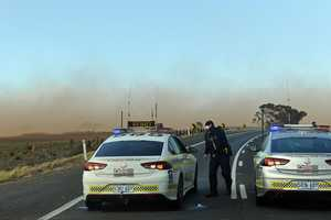 Police on the Sturt Highway are unable to get near the scene of the crash because of the dust storm. Picture: Tom Huntley