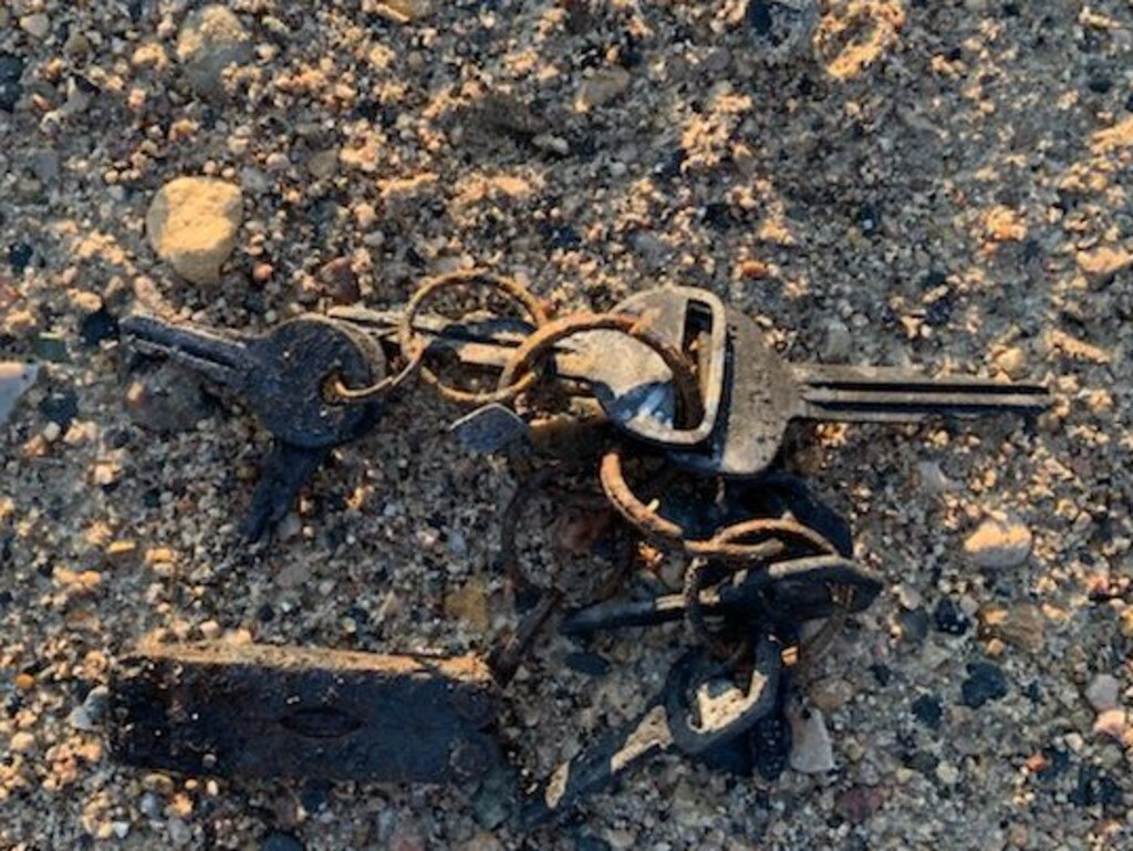 The charred set of keys found on the road beside the fugitives' burnt-out RAV 4 near Gillam on July 22. Picture: Kyle Edwards