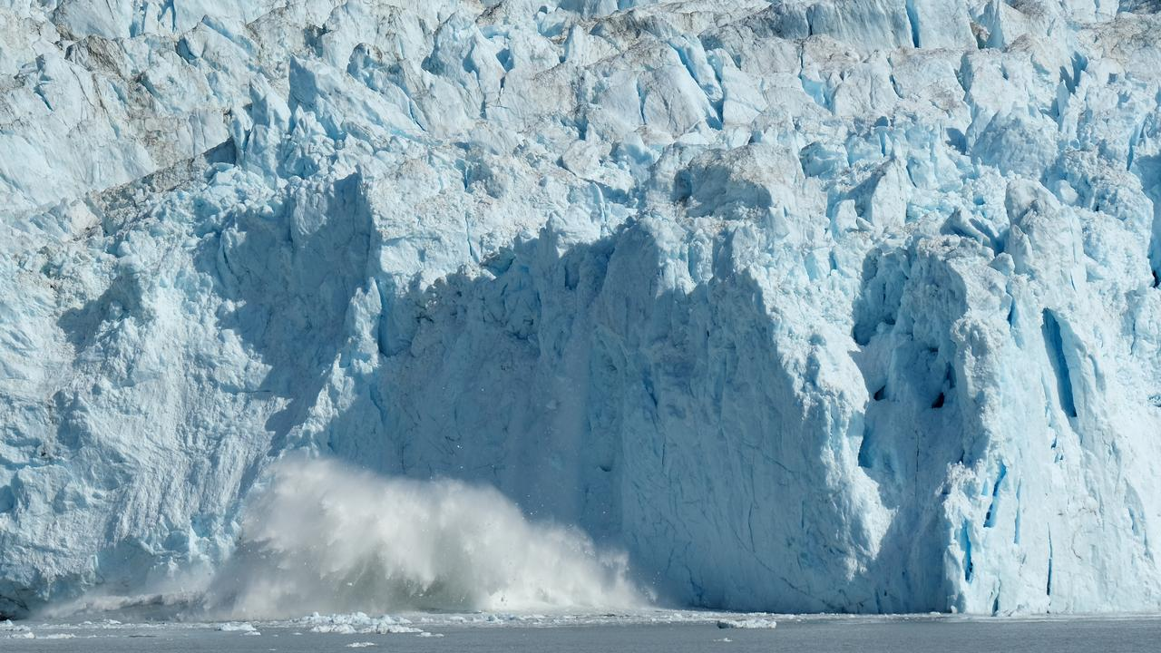 Ice breaking off from the 200 meter tall face of the Eqip Sermia glacier, also called the Eqi glacier, crashes into the water below during unseasonably warm weather on July 31, 2019 at Eqip Sermia, Greenland. Picture: Sean Gallup/Getty Images