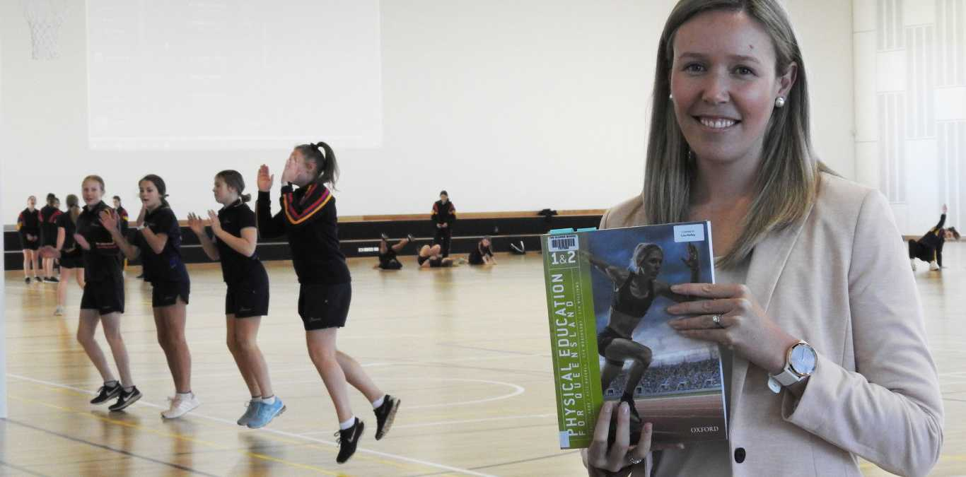 The Glennie School's Health and Physical and Education head of department and past Glennie student Crystal Hede. A book she co-authored with Kate Russell and Ron Weatherby has been shortlisted for the 26th Education Publishing Awards Australia.