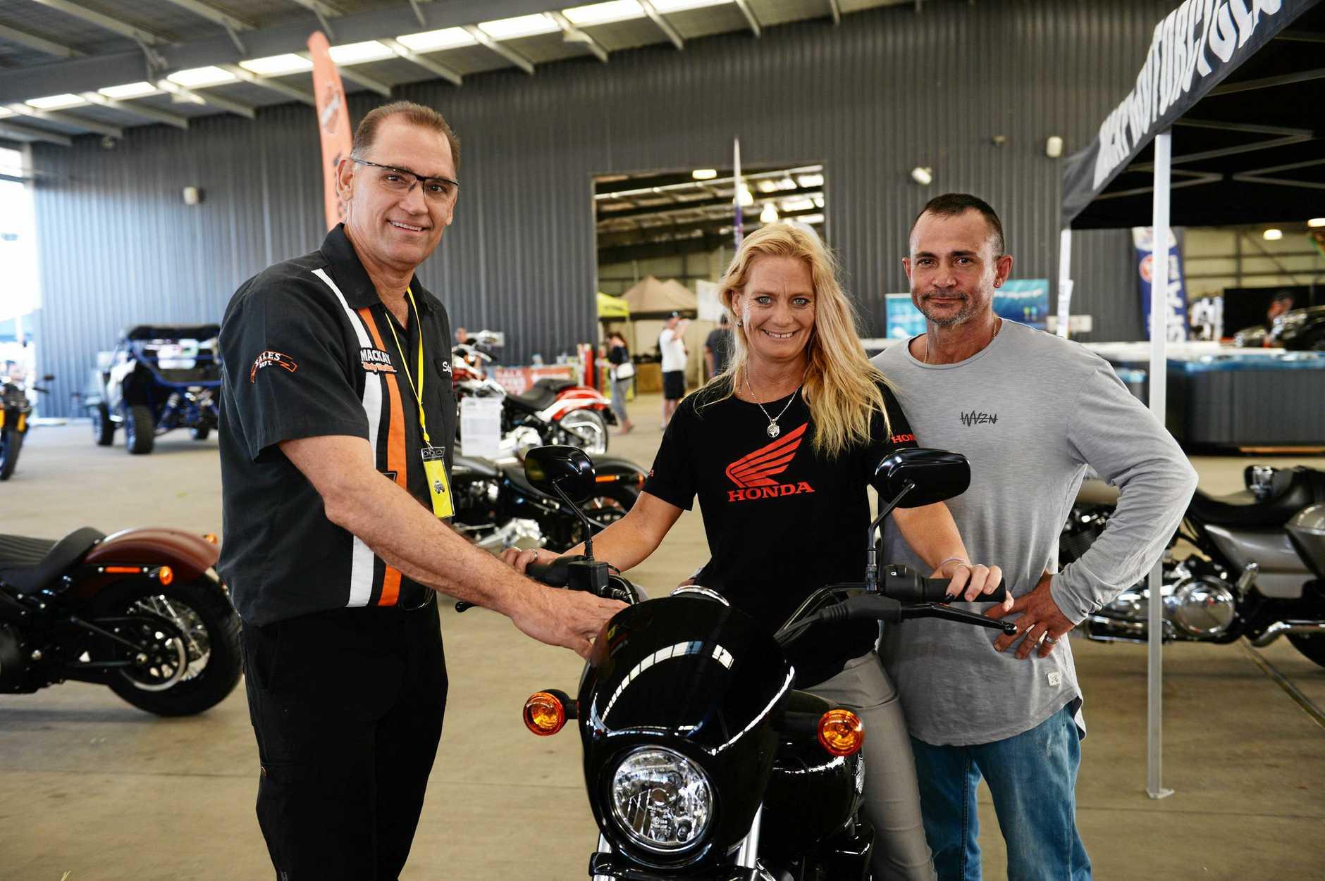 Big Boys Toys expo at Mackay Showgrounds. Scott Gralow of Mackay Motorcycles with Katrina and Anthony Ghilotti