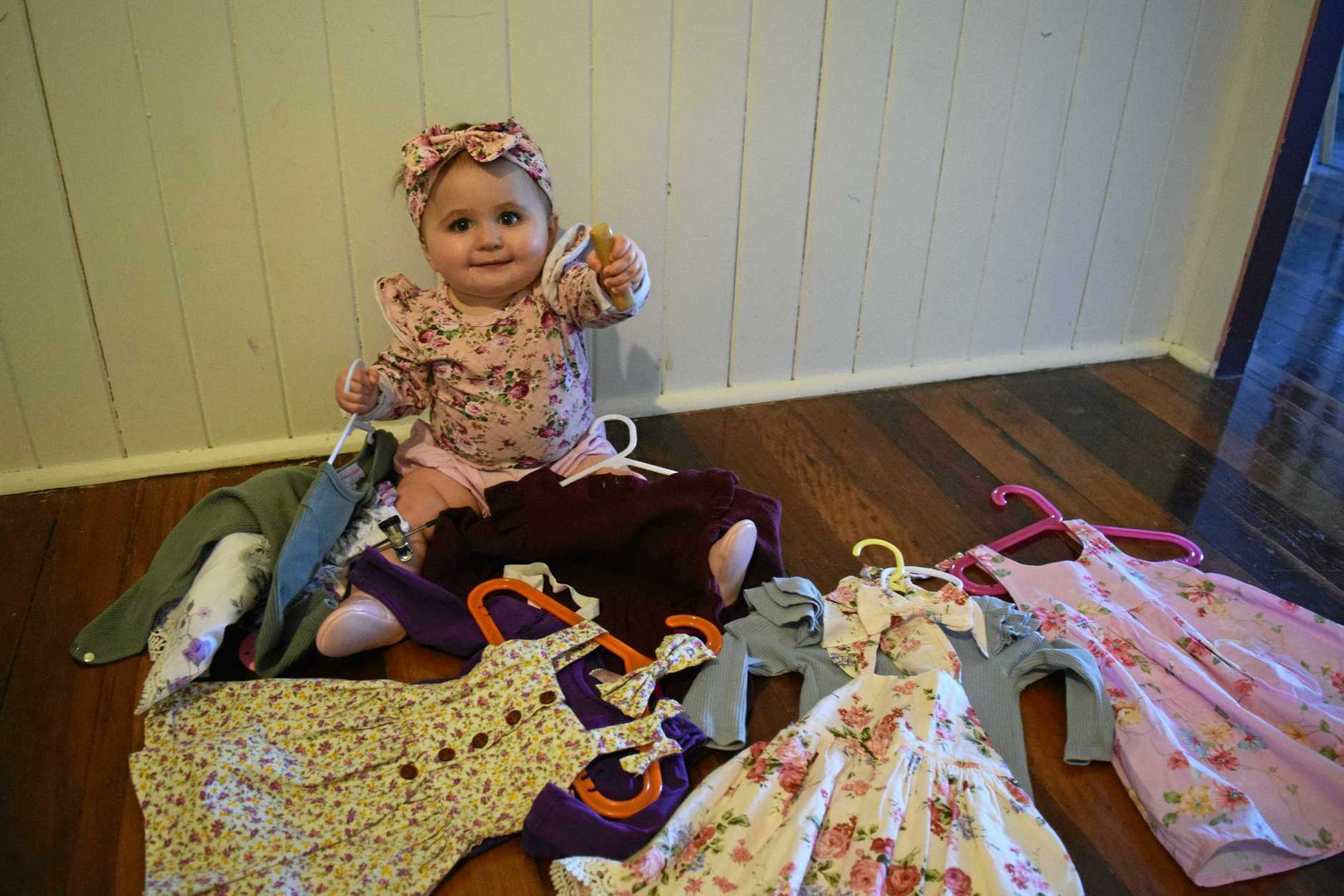 Maryborough's 11-month-old Iris Rankin, with just a few of the many outfits she has, who won the Fraser Coast Chronicle best dressed baby.