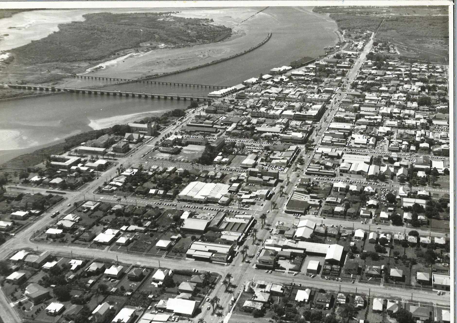 This aerial view of Mackay's CBD, looking from west to east, taken sometime in the 1960s.